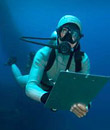 A diver with a writing pad